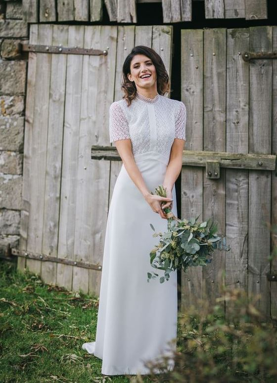 a chic yet modest wedding dress with a boho lace bodice, a turtleneck, short sleeves and a plain skirt