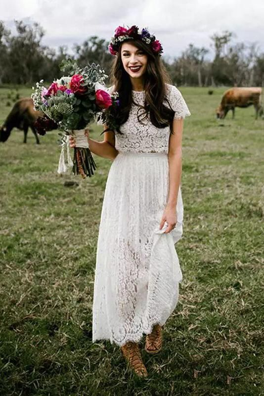 a lace bridal separate with a crop top with a high neckline and short sleeves, a midi skirt and nude booties