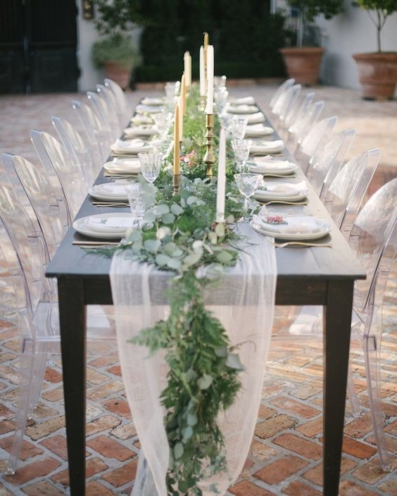 a lush eucalyptus and fern table runner combined with an airy and flowy fabric table runner