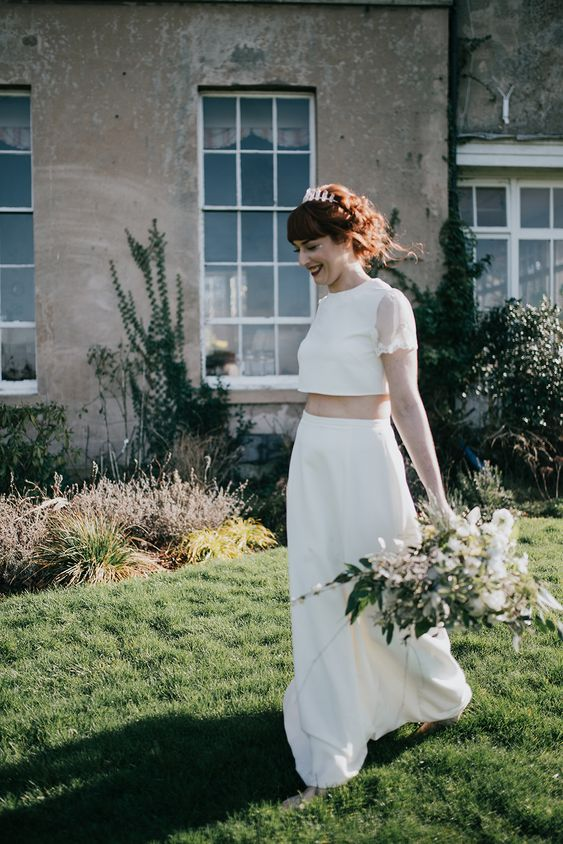 a modern bridal separate with a plain crop with with sheer sleeves and a plain A-line skirt