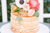 a naked bridal shower cake with kumquats and blush and hot pink blooms on top