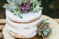 a naked wedding cake with fresh succulents on top and sides will fit both a rustic and boho chic wedding