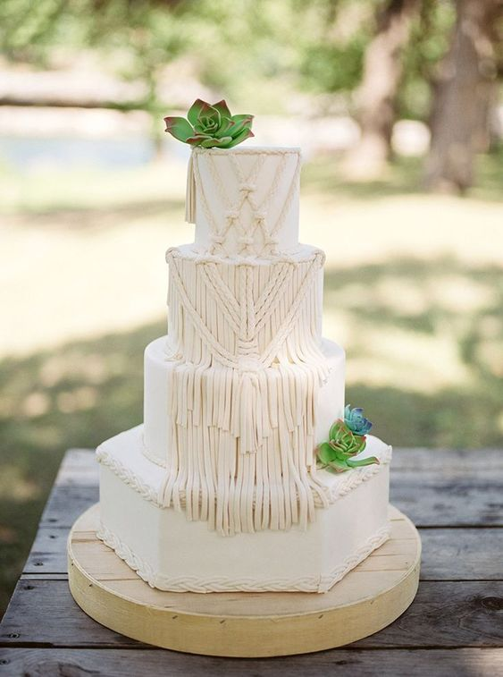 a neutral boho macrame wedding cake with fresh succulents looks really unusual and inspiring