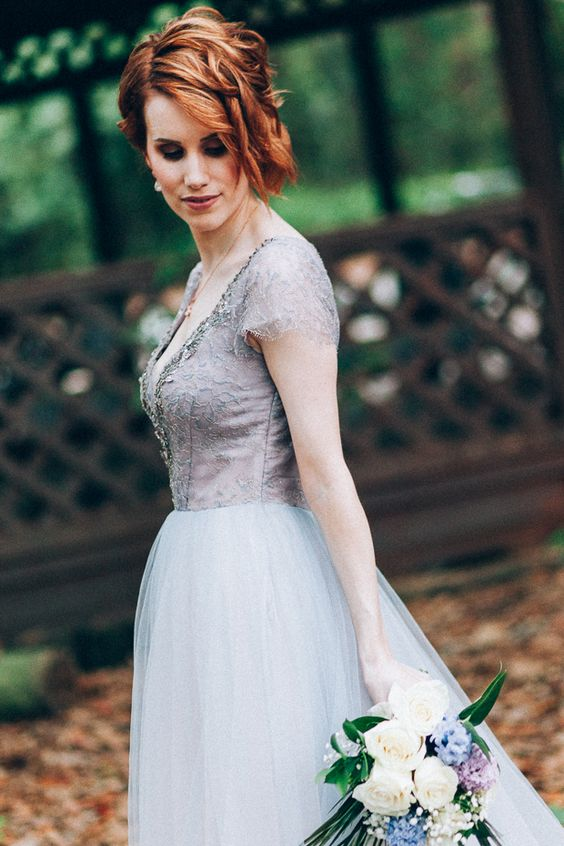 a purple A-line wedding dress with a lace bodice, an embellished neckline and a tulle skirt