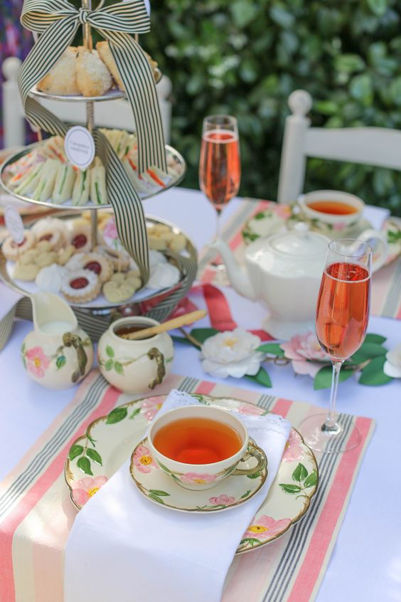a spring tea party bridal shower with floral teaware, lots of sweets and rose is a cool idea
