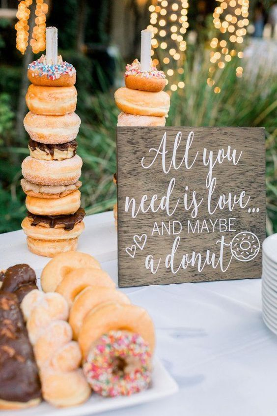 a stylish and simple donut bar with a tray of donuts and sticks to put donuts on them