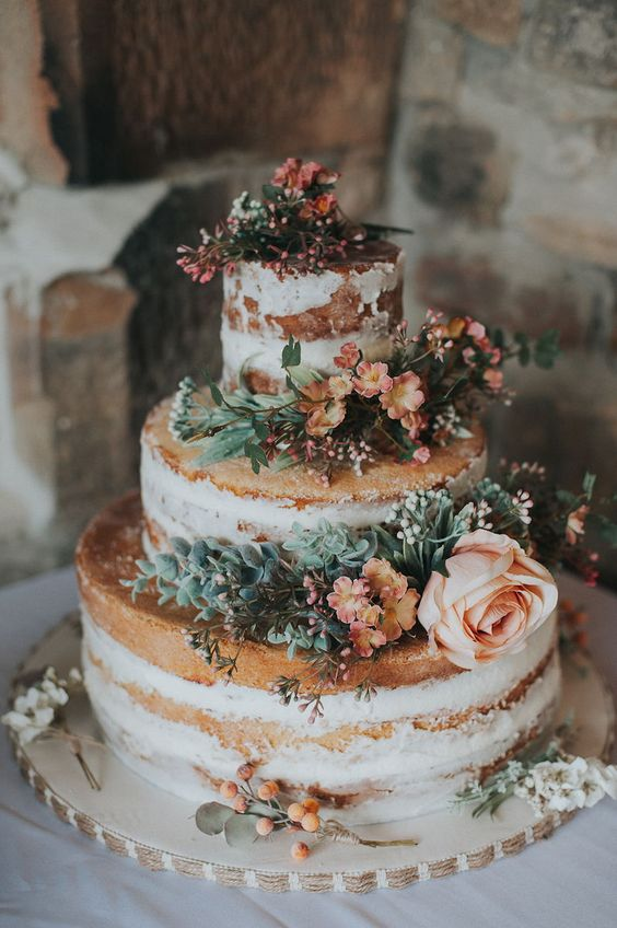 a yummy naked wedding cake with succulents and blush blooms and berries is a lovely idea for a summer rustic wedding
