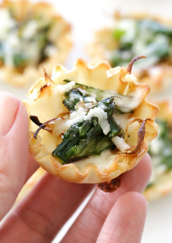 asparagus and caramelized onion tartlets are an easy and delicious spring appetizer