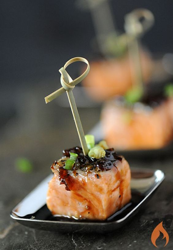 bourbon-glazed salmon appetizers with green onions on skewers is a chic and tasty idea for a spring wedding