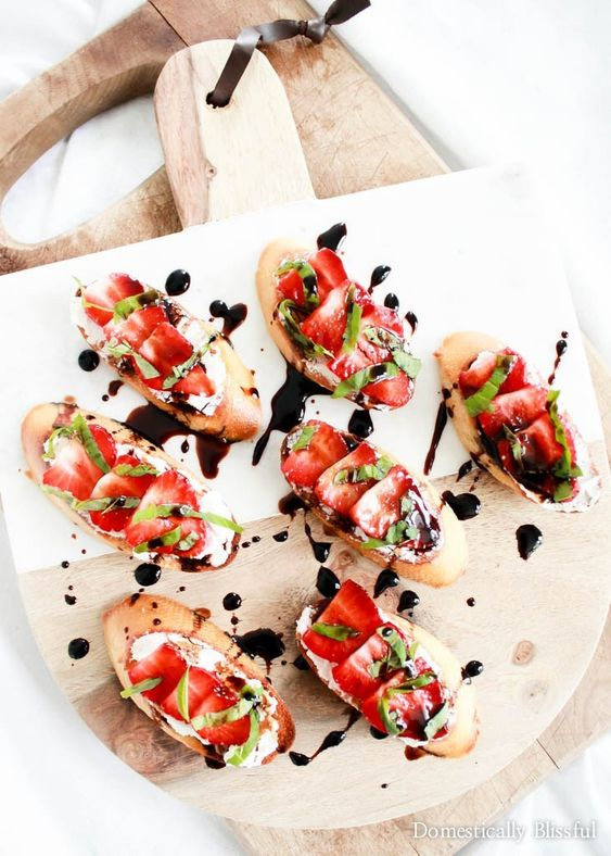 bruschettas with cheam cheese, strawberries, herbs and balsamic are adorable, tasty, healthy and will be loved by everyone