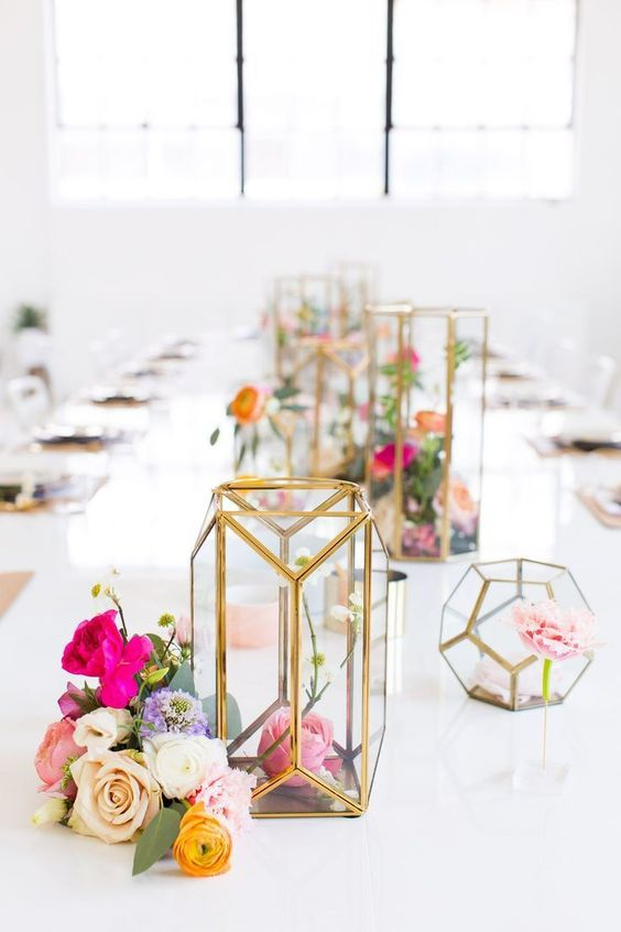 colorful blooms in geometric gold candle lanterns and in arrangements in vases for a spring bridal shower
