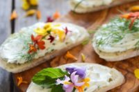 cream cheese and chive sandwiches with edible flowers are perfect for spring and summer weddings