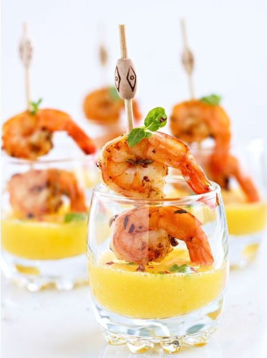 grilled shrimps on skewers with mango dip in cups are tasty, sweet and very fresh