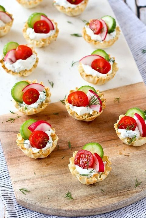 pastry cups with delicious dip, cucumbers, tomatoes and radishes plus herbs for spring
