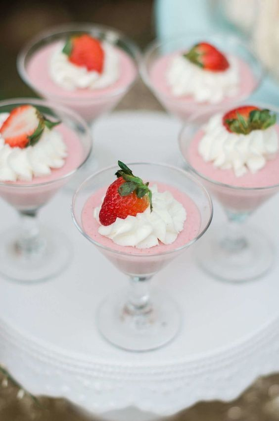 pink souffle in glasses with whipped cream and strawberries are nice for your spring bridal shower