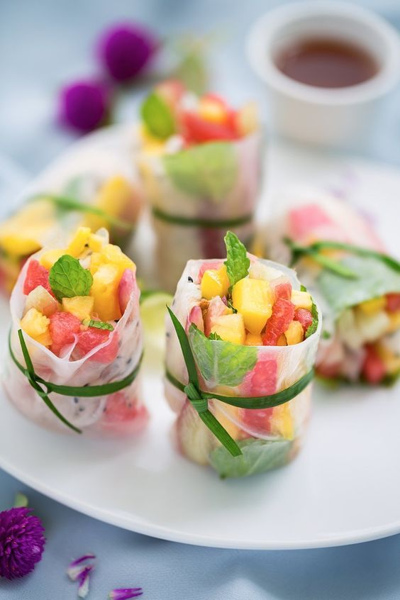 spring rolls with fresh watermelon, mango and pineapple salad plus herbs are delicious and refreshing