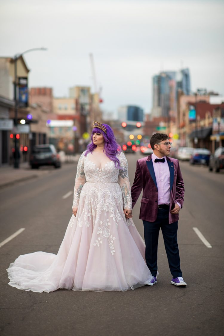 a beautiful blush A-line wedding dress with lace appliques, purple hair and a gorgeous purple and gold crown