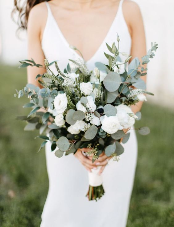 a beautiful textural wedding bouquet of greenery and white blooms will work for most of bridal styles