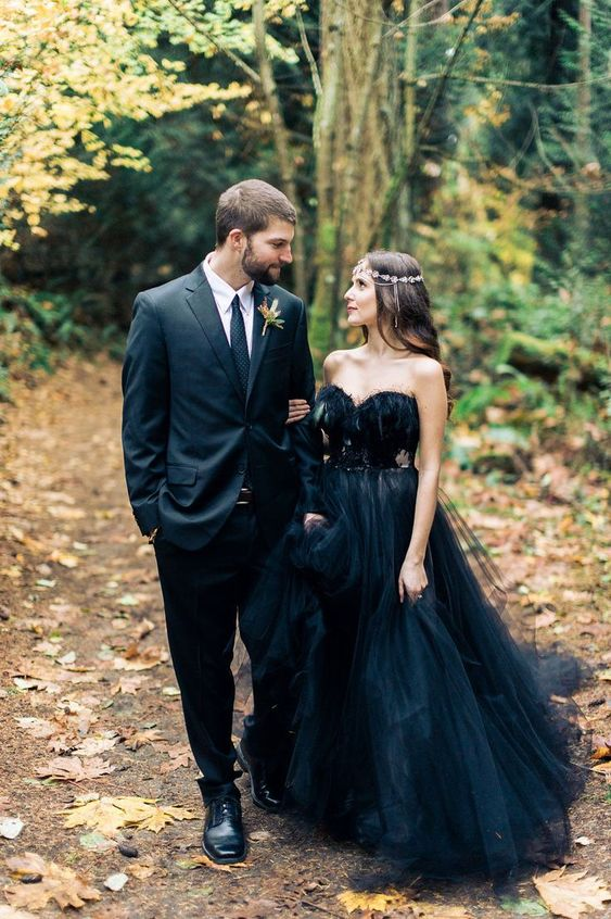 a black strapless wedding ballgown with an embellished sash and a train for a fall woodland wedding