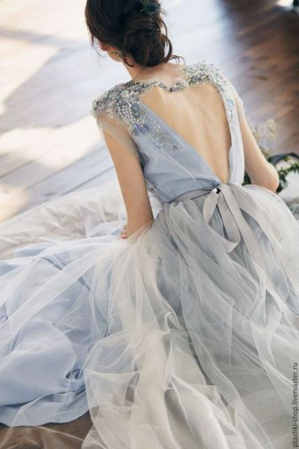 a blue A-line wedding dress with embellishments and embroidery, a low back and a layered skirt is a beautiful idea to rock