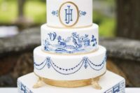 a blue, white and gold wedding cake inspired by chinoiserie is very refined and elegant