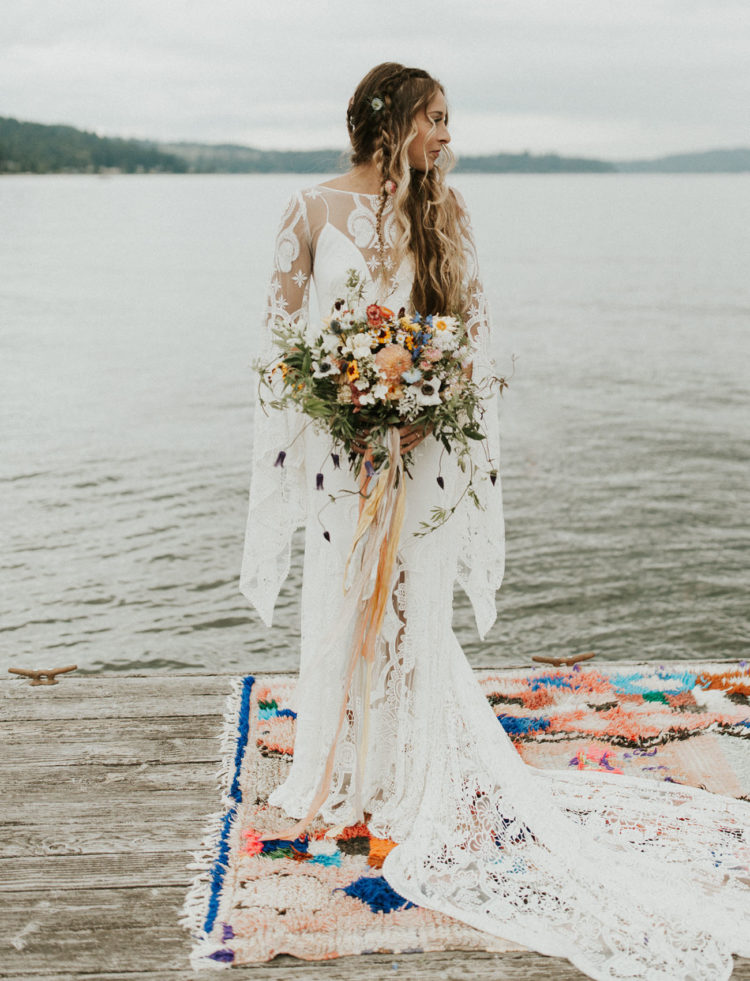 a boho lace wedding dress with bell sleeves, an illusion neckline and a train is a stunning solution for a boho-loving bride