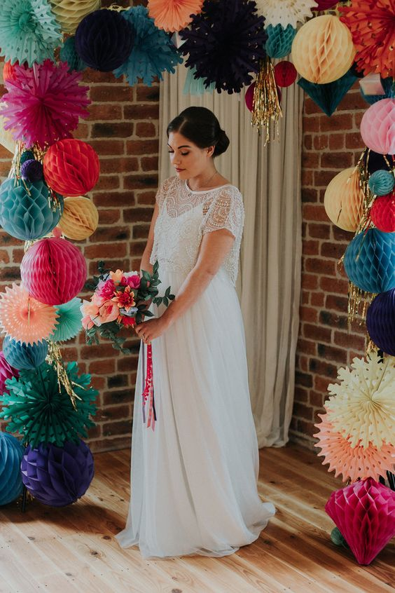 a chic spaghetti strapl plain wedding dress with an embellished crop top with short sleeves