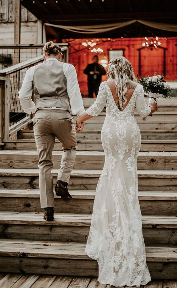 a fabulous mermaid lace wedding dress with short sleeves and a cutout back plus a train is a romantic idea