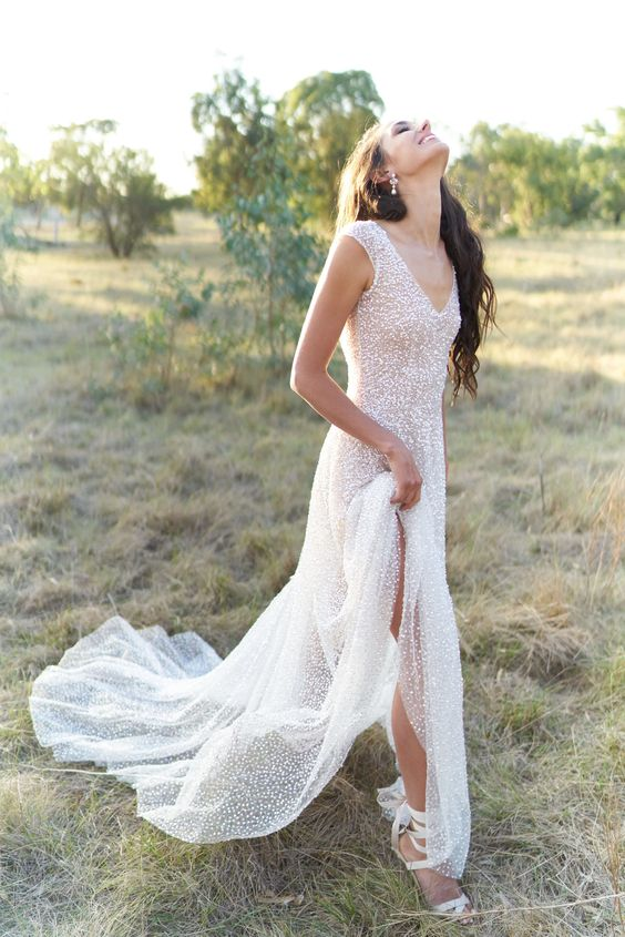 a fully embellished A-line wedding dress with a V-neckline and no sleeves is super glam