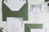 a green and white wedding invitation suite with leafy patterns looks very natural and chic
