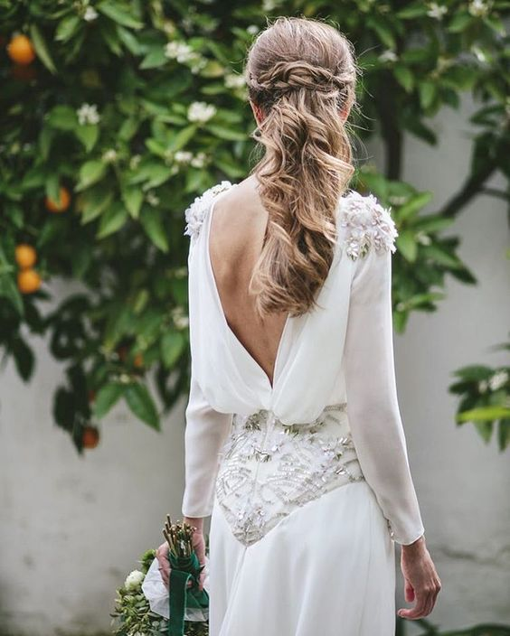 a lovely A-line plain wedding dress with embellishments and lace appliques, a low back and long sleeves is wow