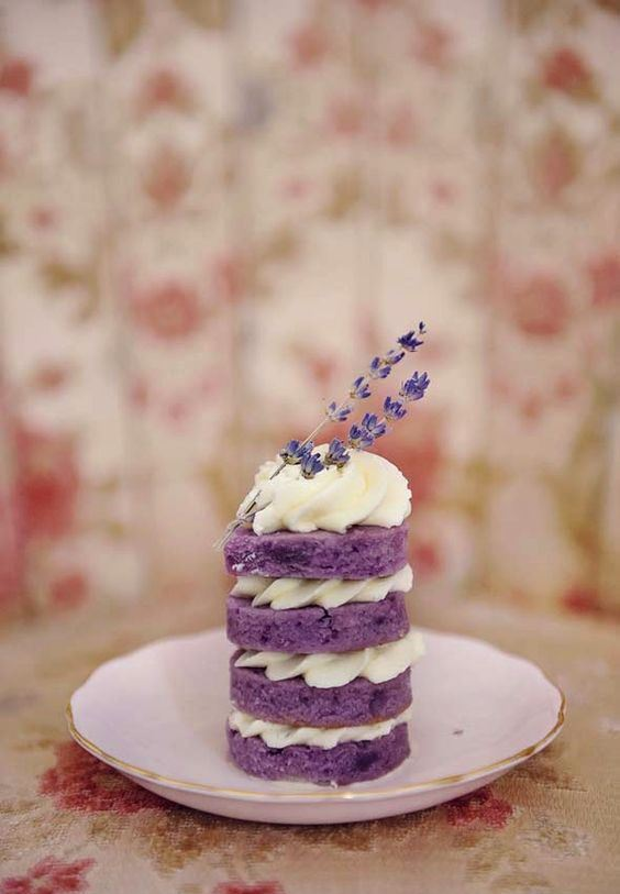 a mini naked lavender wedding cake with whipped cream and lavender on top for a summer wedding