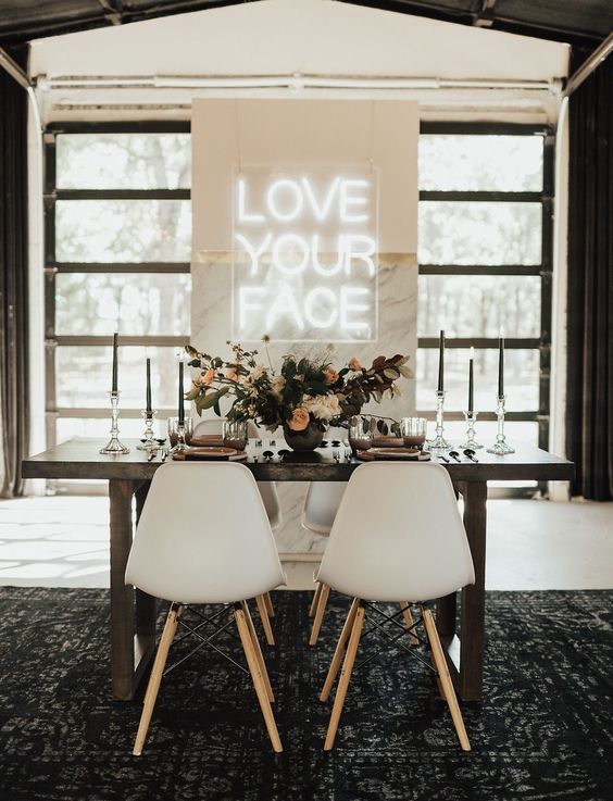 a modern marble reception backdrop with an acrylic neon sign is what you need for a bright and welcoming reception