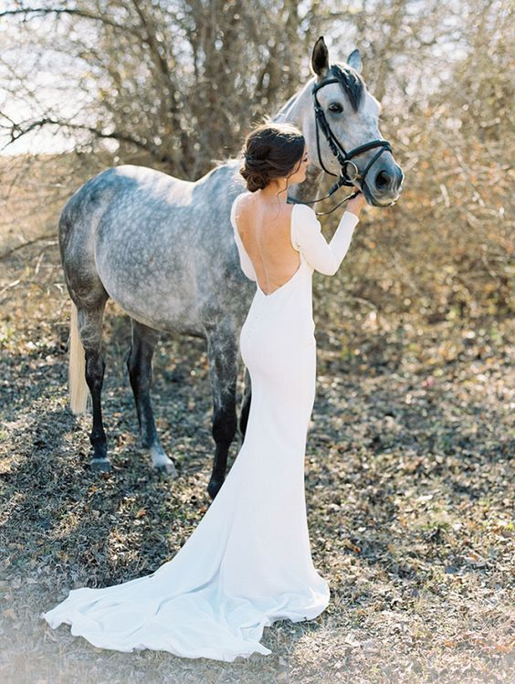 a modern sexy mermaid plain wedding dress with a low back, long sleeves and a train is a refined and gorgeous idea to rock