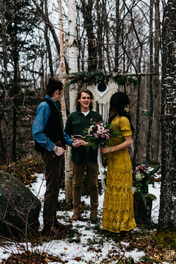 a mustard boho lace sheath wedding dress with short sleeves is a creative idea to stand out in a pale winter woodland scenery