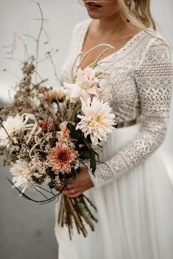 a neutral boho wedding bouquet of blush and white blooms, white touches nd twigs for a boho bride