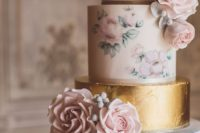a pastel wedding cake with blush floral patterns, a lilac and a gold leaf tier plus fresh and sugar blooms