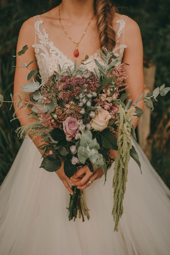 a pretty summer wedding bouquet of pink and blush blooms, greenery of various kinds is great for woodlands