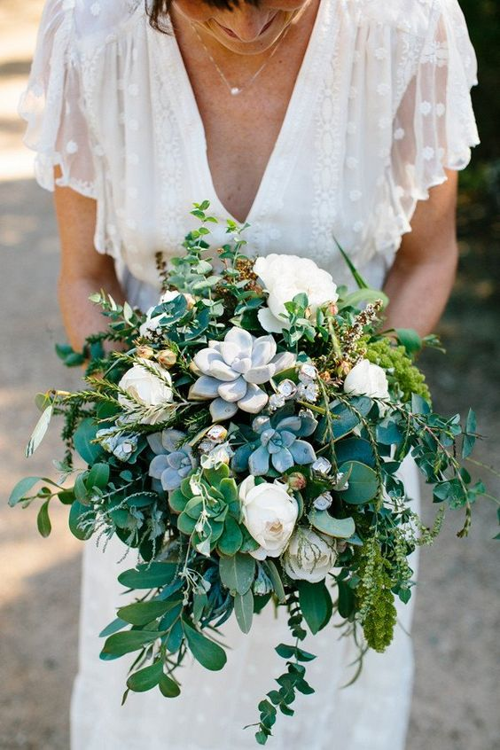 a pretty woodland wedding bouquet of white blooms, greenery and succulents is a lovely idea for a forest bride