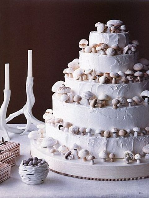 a pure white wedding cake topped with sugar mushrooms is a gorgeous woodland wedding idea