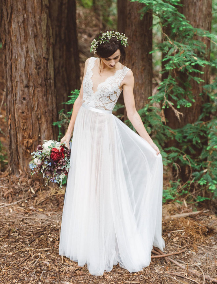 a romantic wedding dress with a lace bodice, an illusion neckline and a pleated skirt plus a floral crown