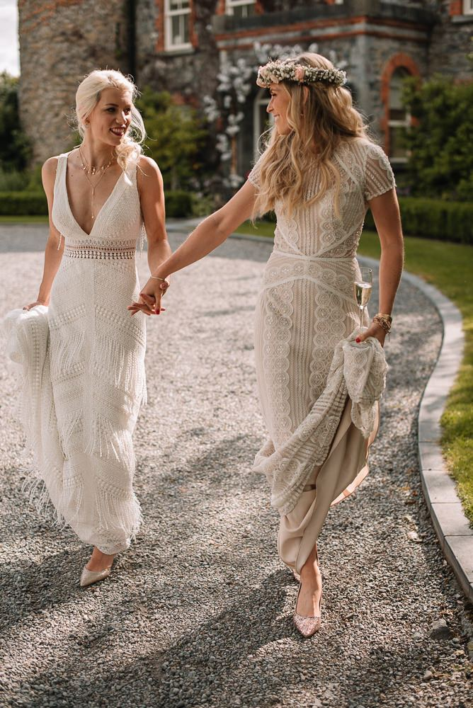 a sheath boho wedding dress with a deep neckline and beading and fringe plus a tan boho lace wedding dress with short sleeves and a high neckline