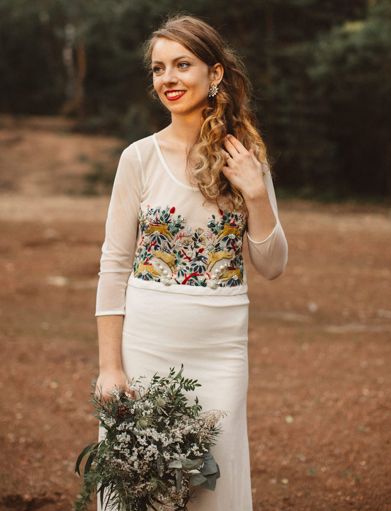 a sheath wedding dress with a colorful embroidered and beaded bodice plus a plain skirt