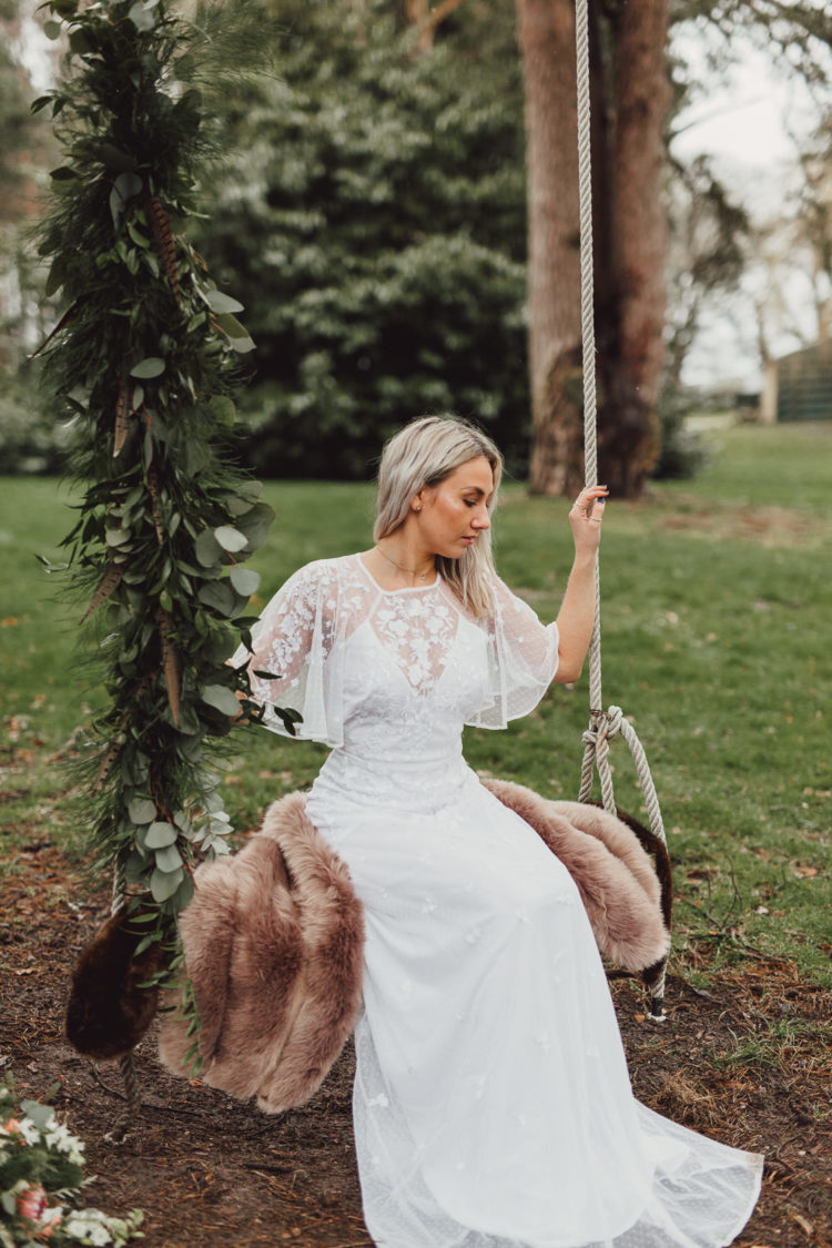 a slip underdress, a lace applique overdress and a faux fur coverup for a fall woodland wedding