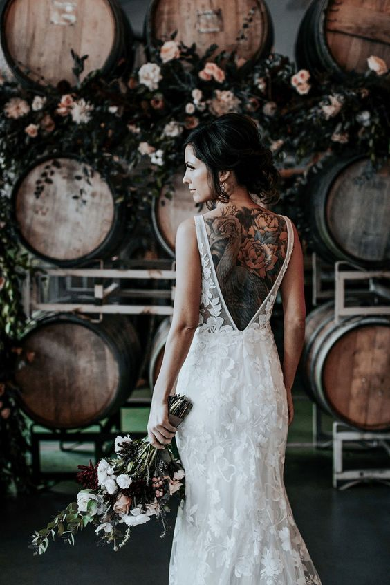 a super romantic lace applique mermaid wedding dress with a low back and thiskc straps is very refined and gorgeous