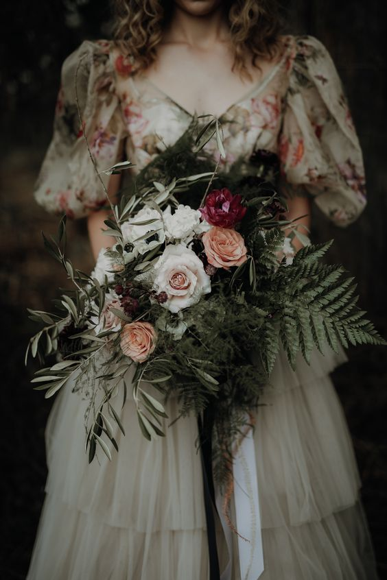 a textural and dimensional wedding bouquet of white, pink and peachy blooms, greenery and berries for a woodland bride
