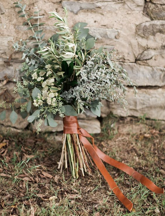 a very textural greenery wedding bouquet with a leather ribbon is a perfect idea for a woodland wedding