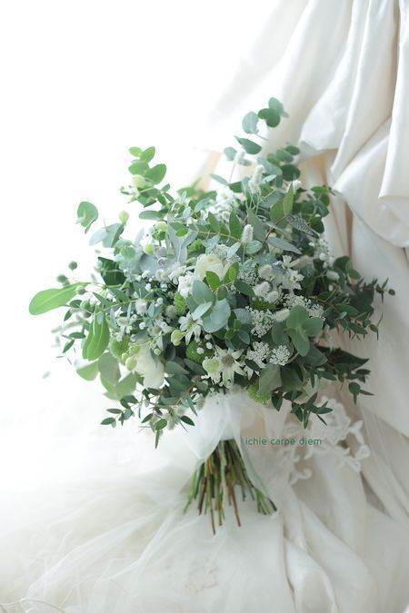 an airy and chic woodland wedding bouquet of greenery and white blooms looks amazing and will fit many weddings