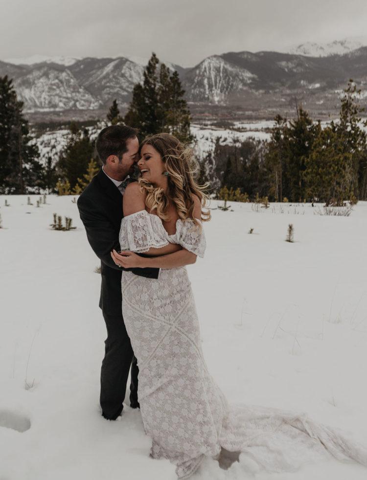 an off the shoulder boho lace wedding dress with a train is a beautiful idea for a boho woodland bride