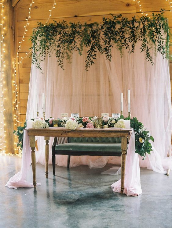 blush sheer curtains with greenery on top is a stylish and simple backdrop, add a matching table runner
